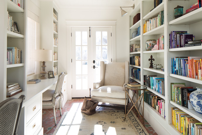 Photo of white office with colorful bookcase from Southern Home