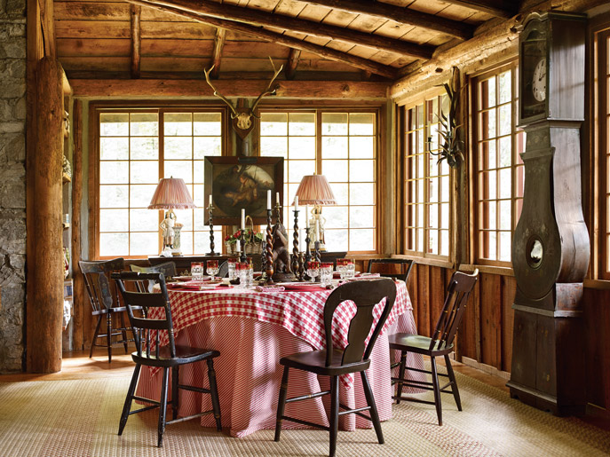 Dining room with mismatched chairs in the Mountainside Hideaway in Southern Home.